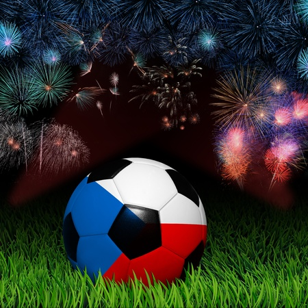 Soccer ball with flag of Czech, fireworks celebration photo