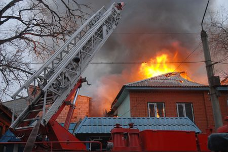 Fire in resident area, Astrakhan, Russia photo