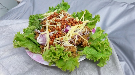 spicy: Spicy deep-fried catfish Salad.