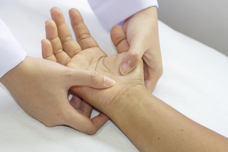 massage therapy: digital pressure hands ,deep fixtion massage therapy physiotherapy  Stock Photo