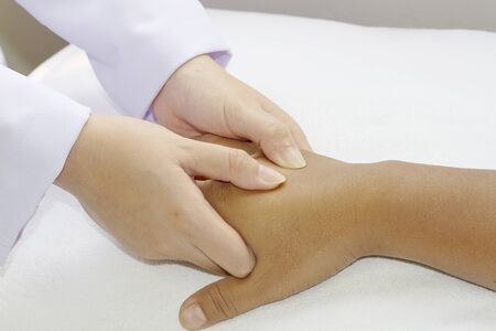 Close-up of  physical therapist giving hand massage in a health center Stock Photo - 12724931