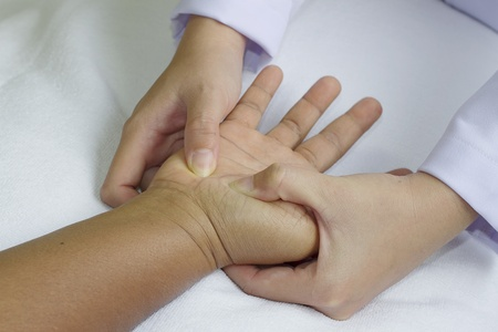 restore energy flow: digital pressure hands ,deep fixtion massage therapy physiotherapy Stock Photo