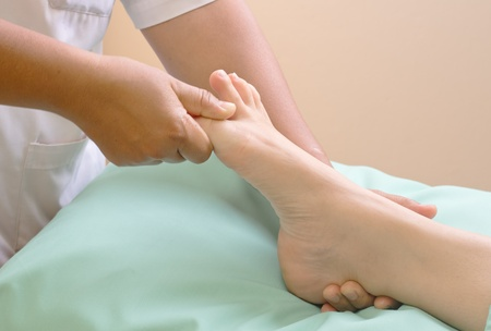 traditional healer: reflexology foot massage, spa foot treatment   Stock Photo