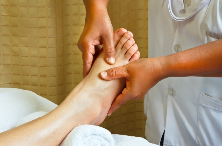 reflexology foot massage, spa foot treatment. Stock Photo - 13156001