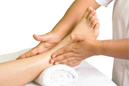 foot massage, spa foot oil treatment  in white background photo