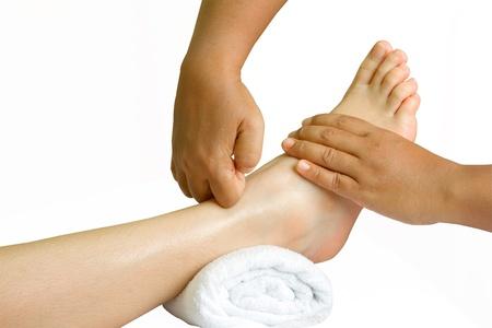 restore energy flow: foot massage, spa foot oil treatment Stock Photo