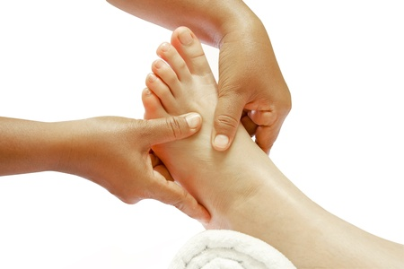 reflexology foot massage, spa foot treatment photo
