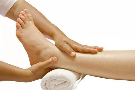 reflexologie plantaire: massage des pieds, traitement � l'huile spa pour les pieds
