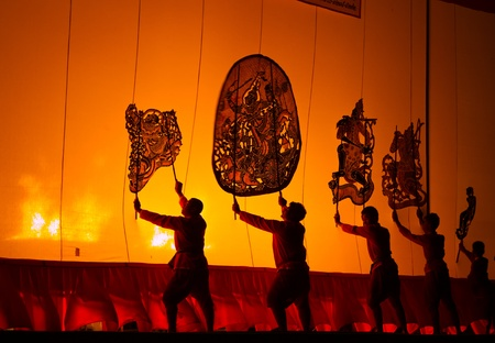RATCHBURI, THAILAND - APRIL 14: Large Shadow Play is performed at Wat Khanon on April 14, 2012. The ancient performing art involves manipulating puppets of cowhide in front of a backlit white screen Stock Photo - 13491635