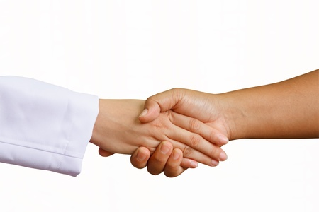 doctor shakes hands with a woman patient with isolated white background  photo