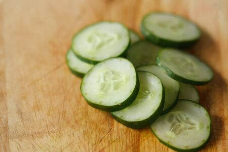 cucumber slice on a wooden board Stock Photo - 13732500
