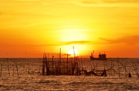 fishing village, Ang Sila Bangsaen chonburi,thailand , beautiful sunset and silhouette. photo