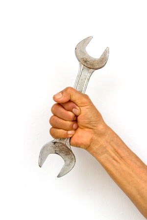Holding wrench in hand on white background photo