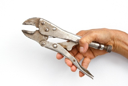 Holding monkey wrench in hand on white background photo