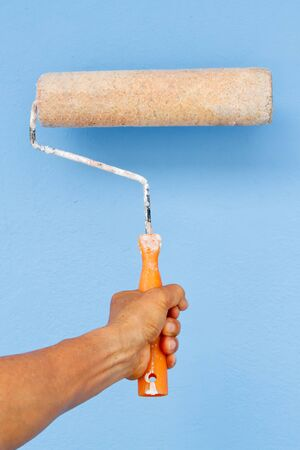 Holding Painting roller in hand Stock Photo - 13854832