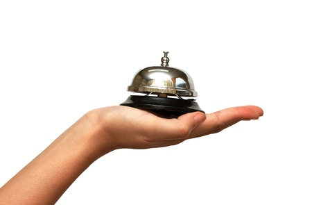 ding: woman hand giveing  a hotel service bell in  isolated background