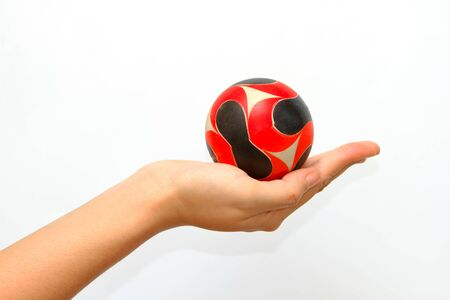 consign: woman hand giveing  a ball in  isolated background,woman hand handle a ball