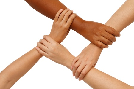 coordination: Hand coordination ,Multiracial hands holding each other in unity