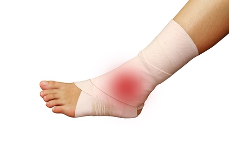 foot and ankle injury wrapped in an ace bandage isolated background Stock Photo