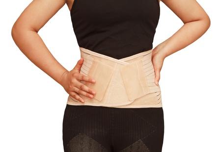Apoyos lumbares, la espalda de apoyo para truma espalda o tensi�n en la espalda muscular, lesi�n aislada de fondo Foto de archivo