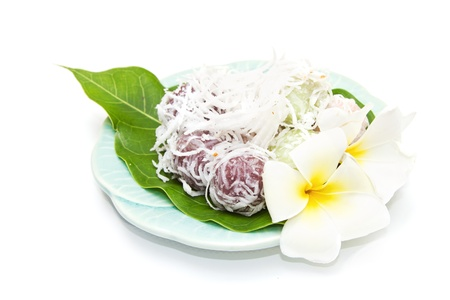 Thai dessert ,Grated Coconut Pudding on white background photo