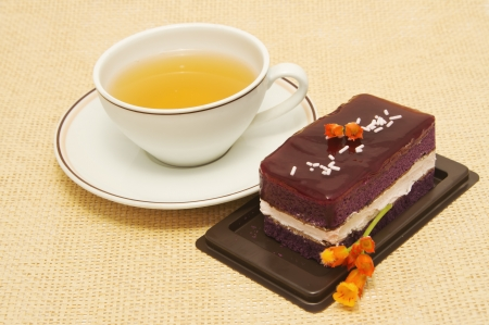 blueberry cheese cake with cup of lemon tea photo