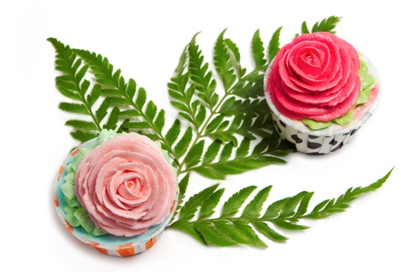 two rose cup cakes for wedding or birthday party on white background photo