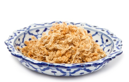 Dried shredded pork in  lai thai dish ,white background photo