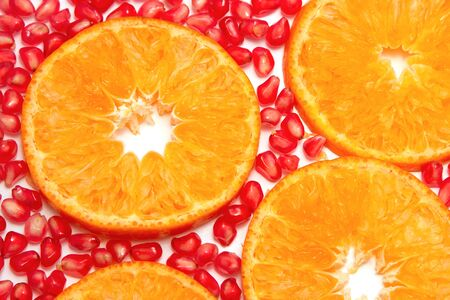 Orange slices pattern and pomegranate seed  isolated on white background photo