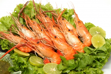 Grilled shrimp with lemon ,seafood dishplay on the dish on white background photo