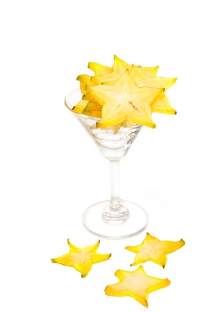 Starfruit, Carambola slice in cocktail grass on white background photo
