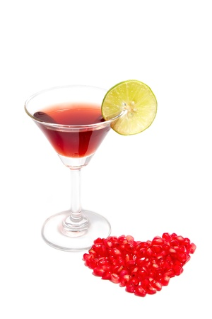 red cocktail pomegranate for good health on isolate background photo