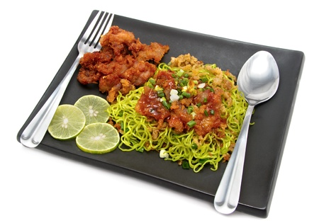 fried pork noodles on white background photo