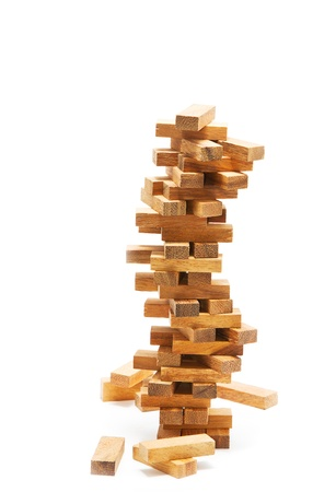 Instability building blocks at risk concept,on white background photo