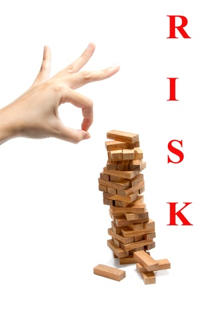 instability: wood blocks instability at risk concept. Abstract meaning business risk Stock Photo