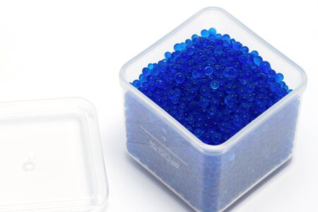damage control: blue silica gel ,moisture adsorbing on white background
