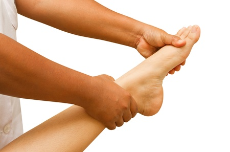 foot doctor:   a physio therapist  test the foot and ankle Stock Photo
