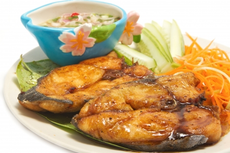 mango fish: fired fish with fishsauce and spicy mango slad ,on white background