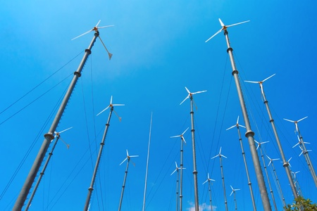 Many wind turbine generating electricity on blue sky Stock Photo - 15400810