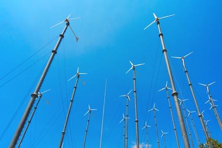 Many wind turbine generating electricity on blue sky Stock Photo - 15400810