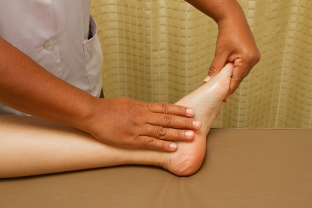 reflexology foot massage, foot spa treatment Stock Photo - 15400833