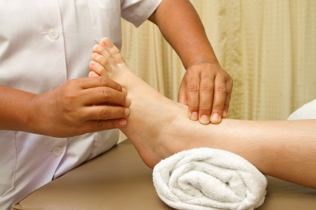 reflexology foot massage, foot spa treatment Stock Photo - 15400834