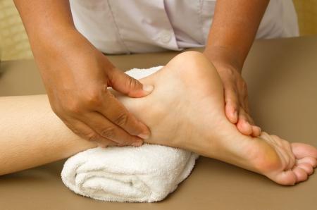 reflexology foot massage, foot spa treatment Stock Photo - 15400812