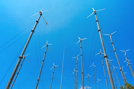 Many wind turbine generating electricity on blue sky Stock Photo - 15421111