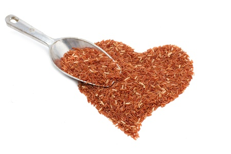 pile of brown rice in heart shape on white background Stock Photo - 15654957