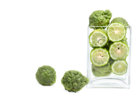 Kaffir lime in glass box  on white background photo