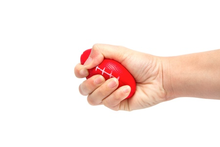 squeezing: woman hand squeezing a stress ball,Abstract meaning being pressured Stock Photo