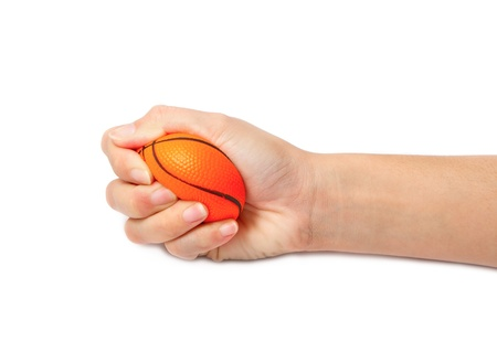 pressured: woman hand squeezing a stress ball,Abstract meaning being pressured Stock Photo