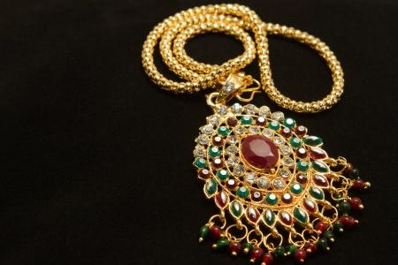 thai stye golden necklace on black background Stock Photo