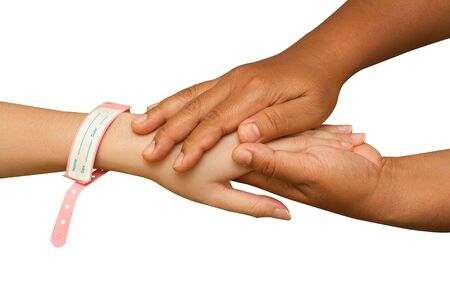 doctor hand helping  patient hand on white background photo